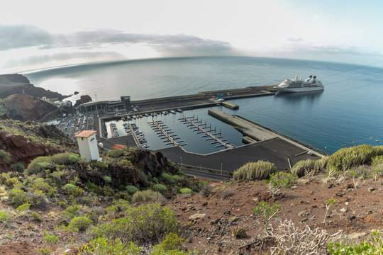 Early morning. Port Puerto de La Estaca on the island of El Hierro, Canary Islands, Spain, with the with a cruise ship anchored