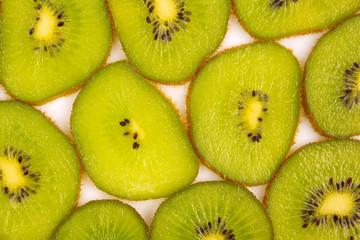 Fototapeta sliced kiwi fruit slices on a white background obraz