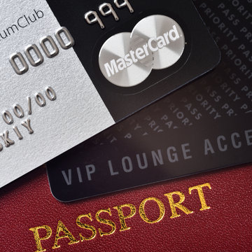 RUSSIA, MOSCOW - FEB 22, 2015: Premium credit card MasterCard Black Edition, Priority Pass card (card for VIP lounge access) and international passport. White background. VIP travel concept