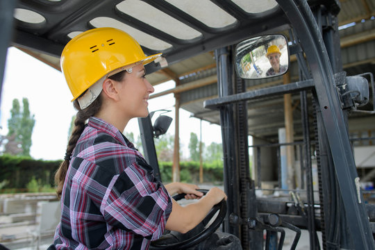 woman learning to drive bulldozer