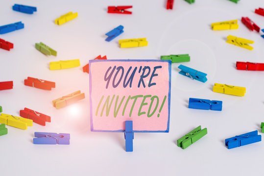 Text sign showing You Re Invited. Business photo text make a polite friendly request to someone go somewhere Colored clothespin papers empty reminder white floor background office