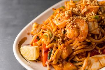 Stir fry Pad Thai with shrimp, squid, tofu, and peanuts.