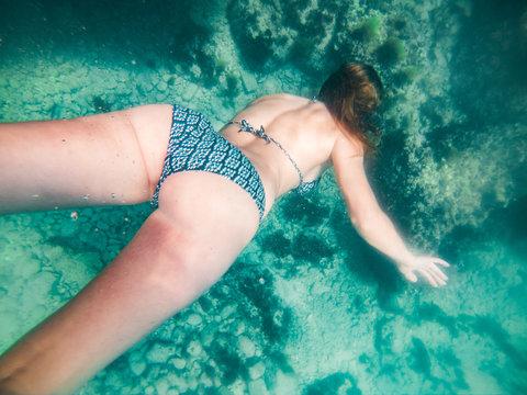 woman in snorkeling mask underwater