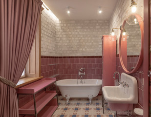 Bath sink and large mirror on brick wall in fashionable bathroom with modern lightening