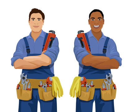 Set of European and African American workers with tools. Cartoon smiling plumbers, repairmen, locksmiths, mechanics, workmen, foremen. Vector illustration isolated on the white background.