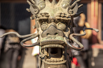 Chinese Dragon statue head with open jaws from Ming dynasty era, in the Forbidden City, Beijing, China Fototapete
