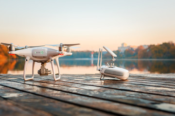 Wall Mural - Drone copter with digital camera, blur river on autumn background