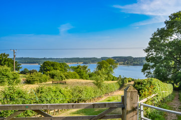 View over a gate towards Rutland Water a large reservoir in Leicestershire