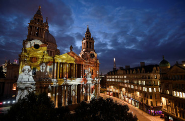 Light projections depicting Second World War images are seen on the west face of St Paul's Cathedral as part of the forthcoming 'Where Light Falls' illuminations and poetry readings, London, Britain