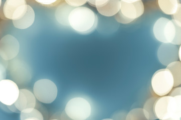 blurred lights in the shape of a heart on a blue background, abstract background image, space for...