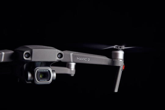 DJI Mavic 2 Pro - Flying in the dark, on black background. Closeup on dark. One of the most portable drones in the market. View on drones gimbal and camera. 12.10.2018 Rostov-on-Don. Russia.