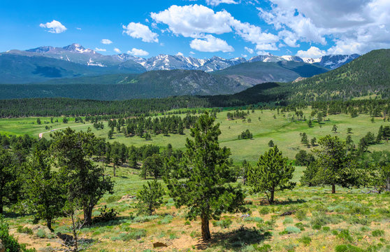 Rocky Mountains summer green panorama in Colorado, USA. Mountains and clouds