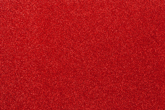Red glitter texture. top view