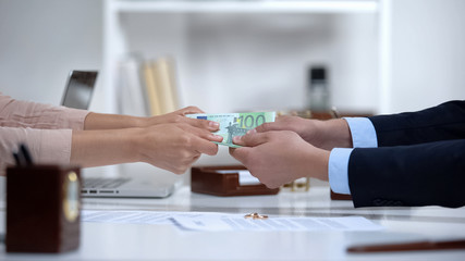 Man and woman hands pulling euro money, dividing marital property during divorce