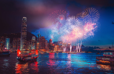 Fototapete - Firework show on Victoria Harbor  in Hong Kong