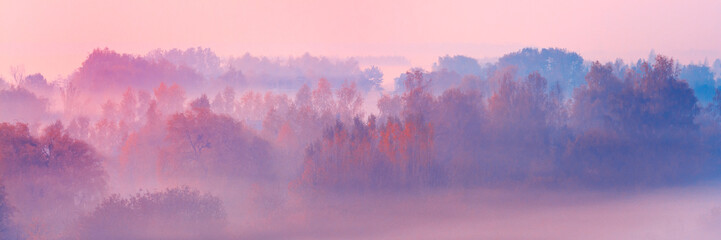 Foto auf Leinwand Rosa hell Banner 3:1. Close-up scenic foggy autumn landscape at sunrise. Aerial view on countryside. Colorful autumnal background. Soft focus