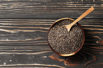 chia in wood bowl with wooden spoons on a background