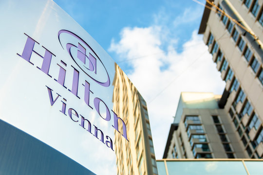hilton hotel logo on the metal pylon in vienna. sign of a luxury 5-star hospitality company