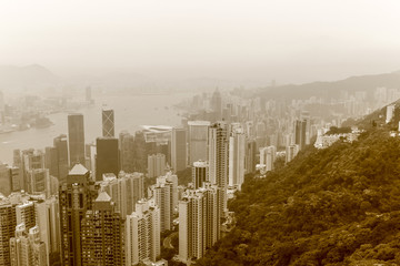 View on Skyscrapers with Victoria Bay, Transportation Ships, Harbour and Kowloon taken from Hongkong Island Peak. Hong Kong, China