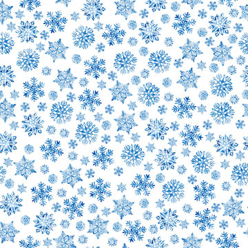 Seamless New Year and Christmas pattern. Blue watercolor snowflakes on a white background. Print for wrapping paper. Hand-drawn winter watercolor background. Snow and blizzard print.