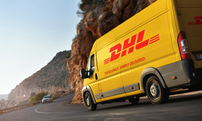 Kas / Turkey - 10.08.18: DHL (Dalsey, Hillblom and Lynn) delivery van speeding by countryside