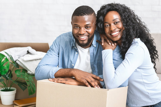 Portrait of happy couple moving in new apartment