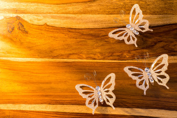 Christmas or easter butterfly decorations on wooden table