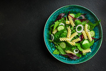 pasta salad Fusilli (leaves Lettuce, Spinach, Vegetables, Gemelli) Menu Concept. food background. copy space. Top view