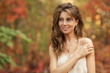 portrait of a beautiful girl on a background of autumn leaves. Blurred background Fotobehang