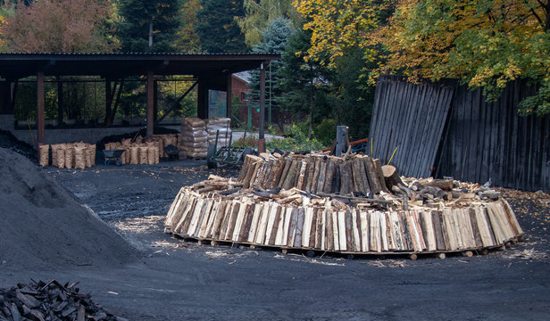 Charcoal pile prepared for churning