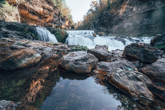 Waterfall at Willow River State Park in Hudson Wisconsin in fall.  Daytime long exposure