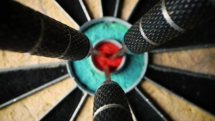 Fototapete - three darts in the center of dartboard - set and achieve your aspirations and goals concept