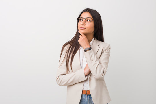 Young business arab woman isolated against a white background looking sideways with doubtful and skeptical expression.