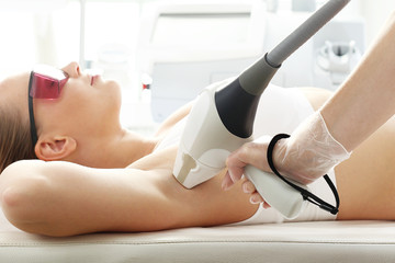 Laser hair removal, armpit hair removal. Woman in a laser hair removal salon