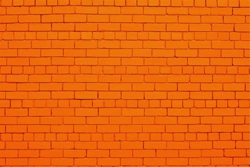 Brick wall painted in orange color.