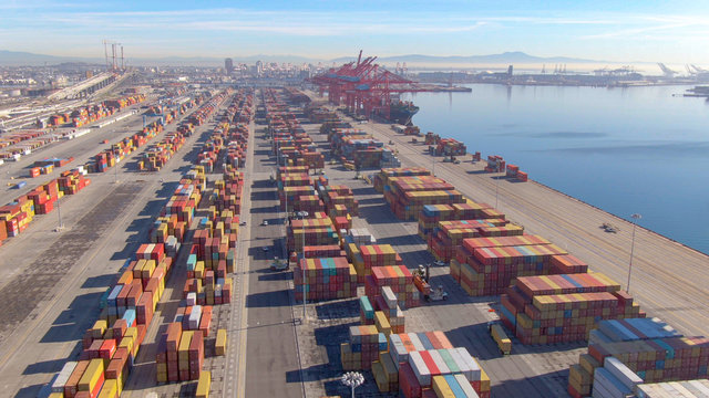DRONE: Stacks of colorful freight containers stretch far out into the distance.