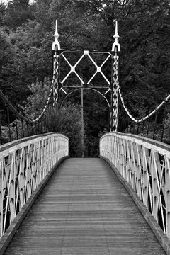 Howley suspension footbridge at victoria park passing over the river mersey. This bridge is around 100 years old and is hidden gem in warrington town, first ever taken this way. England  M