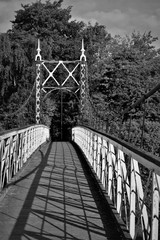 Howley suspension footbridge at victoria park passing over the river mersey. This bridge is around 100 years old and is hidden gem in warrington town, first ever taken this way. England