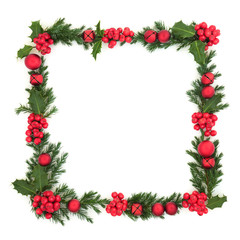 Christmas and winter background border with red bauble ball and bell decorations, holly and juniper...