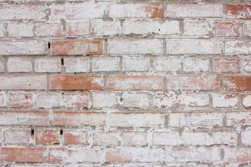The texture of the old brick wall painted white with peeling paint.White grunge brick wall...