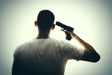 A man commits suicide with a pistol.