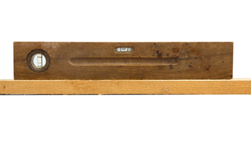 Old vintage wood ruler level meter on the white background