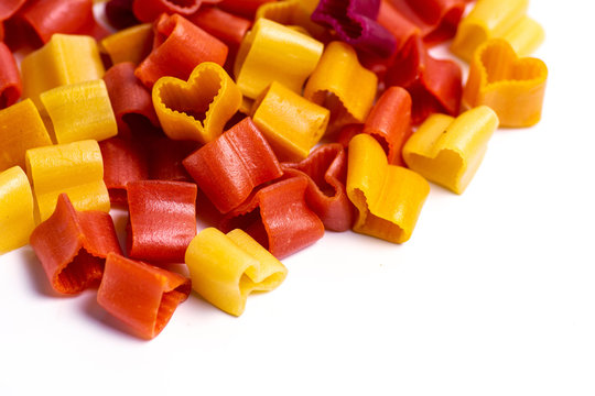 Colorful heart shaped pasta flat lay
