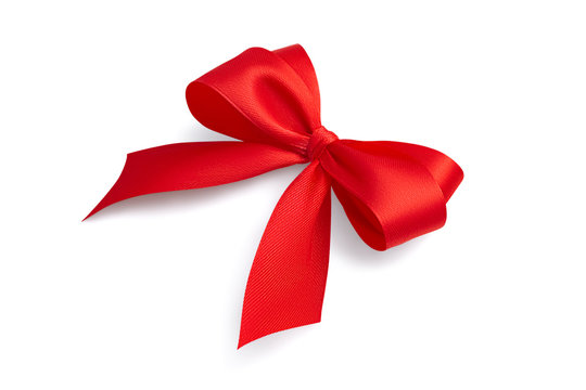 Side view of a beautiful red bright festive four-loop satin ribbon gift bow with gray light soft shadow isolated on white background