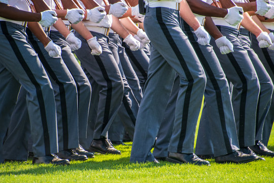 Lower body view of the gray uniform pants of Army cadets as they march