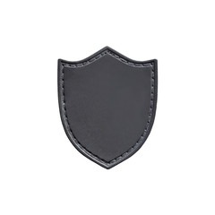 Leather patch in the form of a shield isolated on white background. Chevron