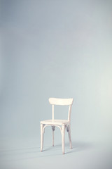 Isolated empty old vintage antique retro classic traditional decorative white paint rustic shabby chic wooden chair seat armchair in studio background backdrop One single solitary on its own by itself