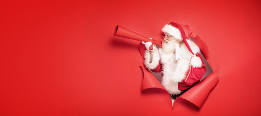 Santa Claus screaming by megaphone.