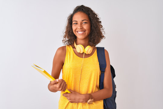 Brazilian student woman wearing backpack holding notebook over isolated white background with a happy face standing and smiling with a confident smile showing teeth