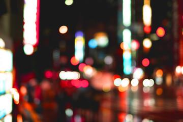 night light and raindrop blur bokeh background on city street Fotomurales